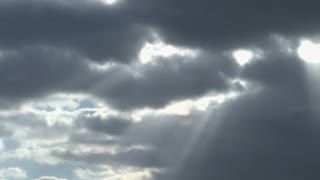 Sun Shining Through Passing Clouds 2