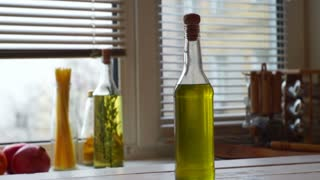 Sunflower oil bottle. Cooking oil in glass bottle. Cooking ingredients. Close up of natural food ingredient in cork bottle at kitchen background. Food products. Extra virgin olive oil