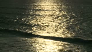 Sunlight Glow On Ocean Surface