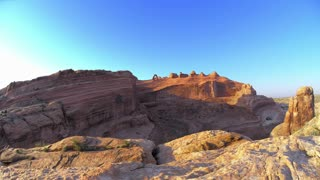 Sunset and Sunrise Over Desert Redrocks Landscape