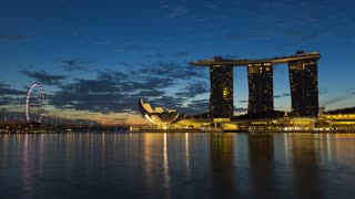 Sunset illuminated view of the Artscience Museum, Ferris wheel, Marina Bay Sands Singapore, Asia, Time lapse