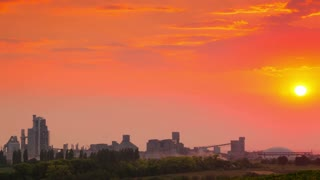 Sunset over Cement Plant. Time Lapse 4K