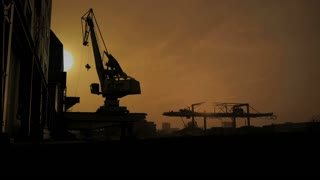 sunset silhouette of crane industrial. time lapse.