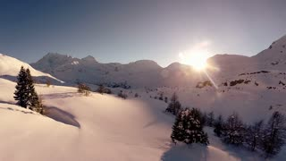 sunset winter landscape. snow covered mountains. aerial view. fly over