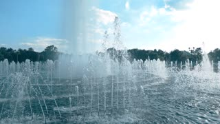 Super slow motion wide lens video of beautiful park fountain, 240 fps