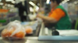 Supermarket checkout bokeh slow motion video