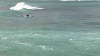 Surfer Paddling Out into Pacific