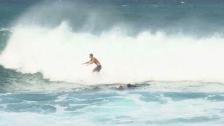 Surfer Riding Wave In