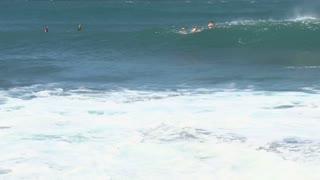 Surfers and Huge Waves 2