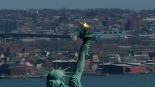 Sweeping Aerial Statue of Liberty's Torch