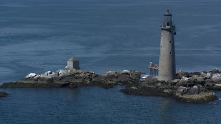 Sweeping Cinematic Aerial Shot Over Boston Harbor Lighthouse