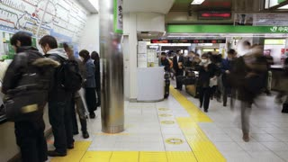 T/L Commuters buying subway tickets from ticket machines at Shinjuku Station , Honshu, Tokyo