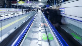 T/L Commuters on a moving walkway in  Shibuya Station at rush hour, Shibuya, Tokyo, Honshu, Japan