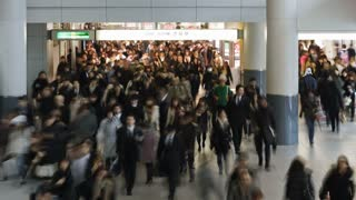 T/L Commuters walking through Shibuya Station at rush hour, Shibuya, Tokyo, Honshu, Japan