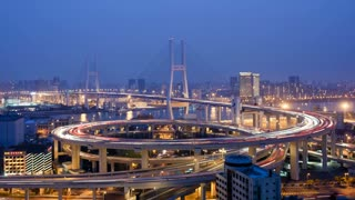 T/L Day to night, High angle wide shot traffic on Nanpu Bridge spiral, Shanghai, China