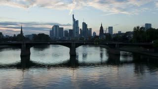 T/L, Germany, Frankfurt, city skyline on river bank, dusk till night