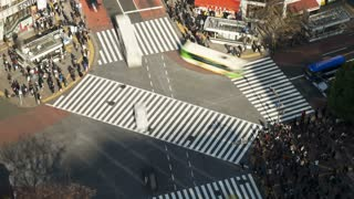 T/L High angle shot pedestrians and traffic across Shibuya Crossing, Hachiko Crossing, Shibuya, Tokyo, Honshu, Japan