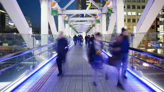 T/L People crossing a pedestrain bridge, Shinjuku, Tokyo, Honshu, Japan