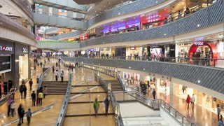 T/L shoppers inside a new modern shopping complex in Pudong district, Shanghai, China