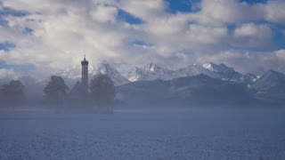 T/L St. Coleman's Church with snowcapped mountain in background, Schwangau, Germany