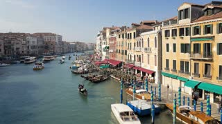 T/LTour boats traveling on Grand Canal near Rialto Bridge, Venice, Veneto, Italy
