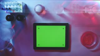 Tablet pc With a Green Screen in the Laboratory.top View.