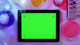 Tablet pc With a Green Screen in the Laboratory.top View