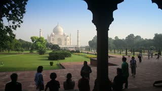 Tourists Looking at Taj Mahal in Background