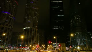 Tall buildings and traffic at night