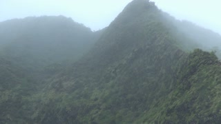 Tall Hawaii Mountain Peak through Fog 2