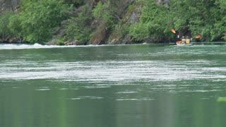 Tandem Kayaks Over Rapids