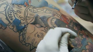 Tattoo artist make tattoo at the studio,close up