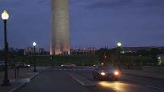 taxi cab and a distant monument, Washington DC