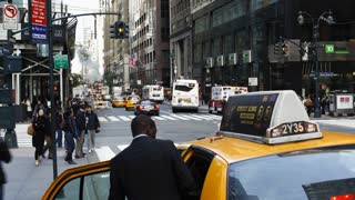 Taxis and street scene at intersection near Grand Central Station, Manhattan, New York City, New York, United States of America, North America, Time-lapse