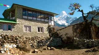 Teahouse with Flags and Ama Dablam Mountain