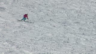 Teen Girl Skiies Down Moguls On Mountain Hill