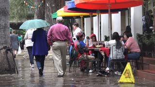 Texas San Antonio people walking past umbrellas