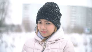 Thai Woman playing with snow slowmotion