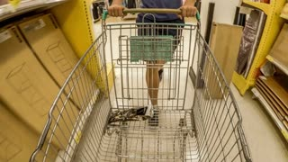 Man with Shopping Cart In Supermarket. 4K. Time Lapse