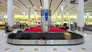 The arrival of luggage on the carousel at Dubai International Airport, Dubai, United Arab Emirates, T/Lapse
