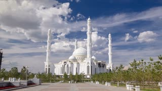 The Hazrat Sultan Mosque in Astana timelapse hyperlapse with blue cloudy sky, Kazakhstan