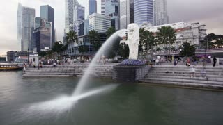 The Merlion Statue with the City Skyline in the background, Marina Bay, Singapore, South East Asia, Time lapse