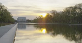 the Reflecting Pool at sunset with tourists