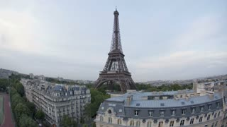 The world famous Eiffel Tower in natural and Illuminated light, Paris, France, Europe - Day to night Time lapse transition