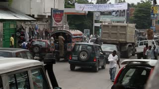 This Street Scene With Pedestrians And Cars Port-au-prince Haiti