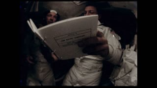 Three Astronauts Reading Manual