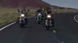 Three Bikers On A Winding Desert Highway