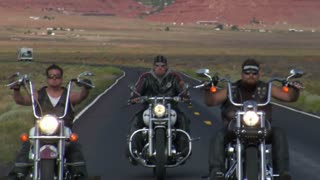 Three Bikers On Desert Highway, Truck Passes