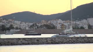 Three Boats Cruising by Town in Spain