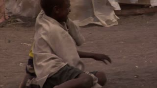 Three Boys Interact with Each Other in Kenya
